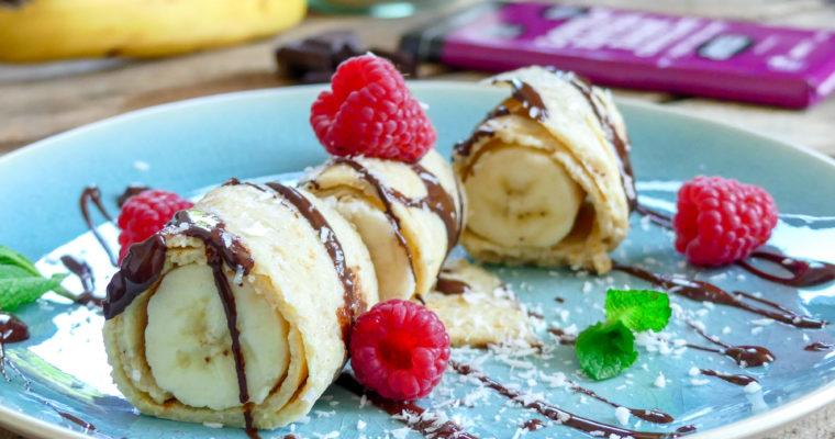 Opgerolde flensjes met banaan en chocolade